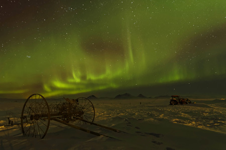 magnetosphere: Aurora Borealis in Iceland skies. Auroras are produced when the magnetosphere is disturbed by the solar win. Stock Photo
