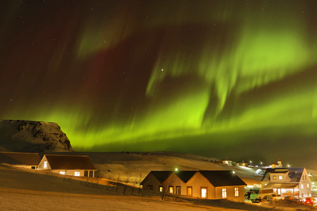 magnetosphere: Strong Aurora Borealis in Iceland skies. Auroras are produced when the magnetosphere is disturbed by the solar win.