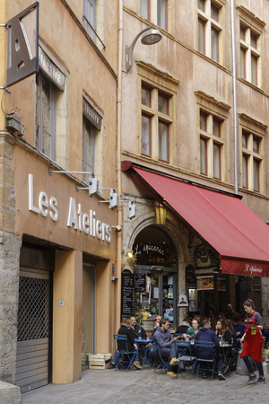 possesses: LYON, FRANCE, April 9, 2016 : Small typical restaurant of the region of Lyon, called Bouchon. Lyon possesses one of the biggest concentrations of restaurants of France.