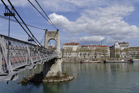 lyon: LYON, FRANCE, April 9, 2016 : Pedestrian bridge called Passerelle du College over the Rhone river  in the city of Lyon.