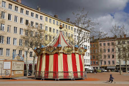 nicknamed: LYON, FRANCE, April 8, 2016 : Merry-go-round on the place de la Croix-Rousse in Lyon. Croix-Rousse district is nicknamed hill that works.