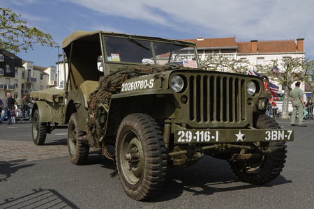 world village: PUY-GUILLAUME, FRANCE, May 7, 2016 : Collectors association of military vehicles commemorates the ending of the Second World War in the village of Puy-Guillaume. Editorial