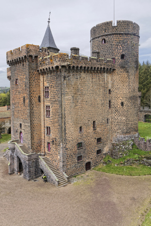 owes: PONTGIBAUD, FRANCE, May 6, 2016 : Chateau-Dauphin is a medieval castle in Pontgibaud, Puy-de-Dome. The castle owes its name to the coat of arms of the Count of Auvergne who built it in the 12th century.