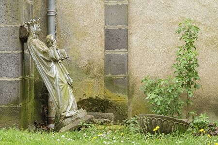 owes: PONTGIBAUD, FRANCE, May 6, 2016 : An old statue in Chateau-Dauphin medieval castle. The castle owes its name to the coat of arms of the Count of Auvergne who built it in the 12th century. Editorial