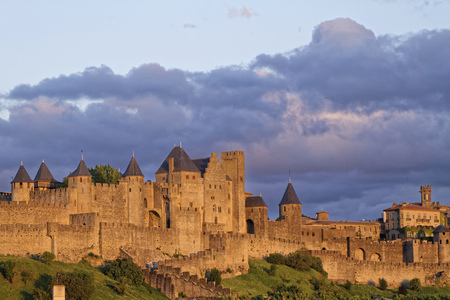 derives: CARCASSONNE, FRANCE, May 29, 2016 : Founded during the Gallo-Roman period, the citadel derives its reputation from its 2 miles long double surrounding walls interspersed by 52 towers.
