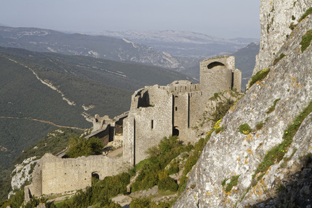 denote: DUILHAC, FRANCE, May 27, 2016 : Peyrepertuse is a ruined fortress and one of the Cathar castles. Cathar castles is a modern term used by the tourism industry to denote a number of medieval castles of the Languedoc region.
