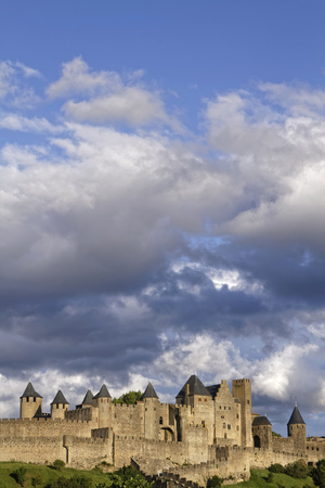 surrounding: CARCASSONNE, FRANCE, May 29, 2016 : Founded during the Gallo-Roman period, the citadel derives its reputation from its 2 miles long double surrounding walls interspersed by 52 towers.