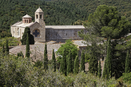 restored: FONTFROIDE, FRANCE, May 30, 2016 : Fontfroide Abbey or Abbaye Sainte-Marie de Fontfroide is a former Cistercian monastery. It has been restored over a number of years and used as a centre for artistic projects Editorial