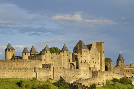 monument historical monument: CARCASSONNE, FRANCE, May 29, 2016 : Founded during the Gallo-Roman period, the citadel derives its reputation from its 2 miles long double surrounding walls interspersed by 52 towers.