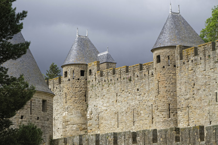 interspersed: CARCASSONNE, FRANCE, May 29, 2016 : Founded during the Gallo-Roman period, the citadel derives its reputation from its 2 miles long double surrounding walls interspersed by 52 towers.