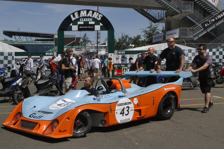 24 month old: LE MANS, FRANCE, July 10, 2016 : Gulf Mirage out of paddock of Le Mans Classic on the circuit of the 24 hours. No other event in the world assembles so many old racing cars in the same place.