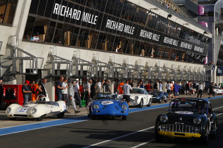 24 month old: LE MANS, FRANCE, July 9, 2016 : In the pitlane during Le Mans Classic on the circuit of the 24 hours. No other event in the world assembles so many old racing cars in the same place. Editorial