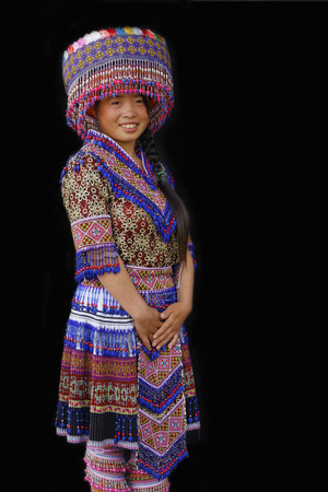 SIN CHENG, VIETNAM, October 26, 2016 : A young HMong lady. Women of North Vietnam mountains wear their best traditional clothes when going to the village for the weekly market. Editorial