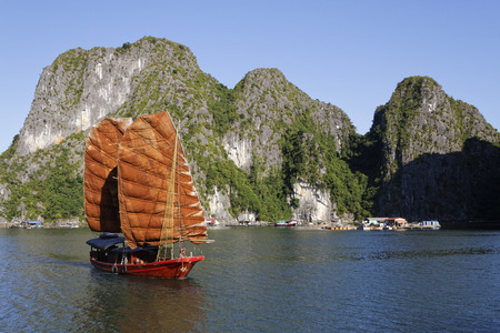 CAT BA, VIETNAM, October 27, 2016 : Traditional junk sails in Cat Ba Archipelago, the southeastern edge of Ha Long Bay. Ha Long Bay has been inscribed in the World Heritage List according to its limestone karstic geomorphologic features.