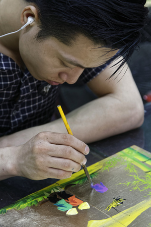 HANOI, VIETNAM, October 30, 2016 : Unidentified artist paints in a workshop of lacquer of Hanoi. Lacquerware are objects decoratively covered with lacquer, mostly from East Asian cultures.