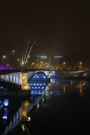 LYON, FRANCE, December 7, 2016: Lights on Lafayette bridge over Rhone river. The Festival of Lights (French: Fete des-Light) express gratitude Toward Mother Mary December 8th around with different light shows Each year.
