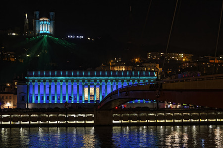 expresses: LYON, FRANCE, December 8, 2016 : Lights on Court Law and Basilica. The Festival of Lights expresses gratitude toward Mother Mary around December 8th with different light shows each year.