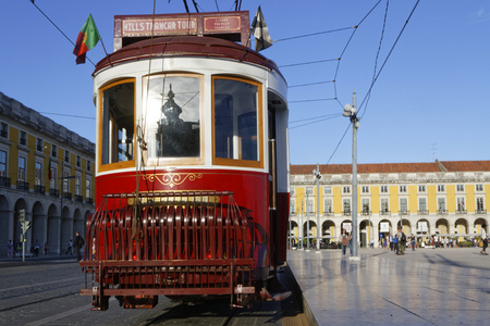 presently: LISBON, Portugal, April 5, 2017 : Tramway in Praca do Commercio. The tramway network serves the capital city of Portugal since 1873. It presently comprises five remaining urban lines in the center Editorial