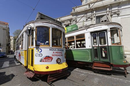 baixa: LISBON, Portugal, April 5, 2017 : Tramway in Lisbon city center. The tramway network serves the capital city of Portugal since 1873. It presently comprises five remaining urban lines in the center Editorial