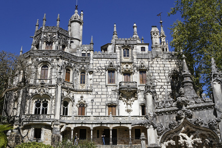 SINTRA, Portugal, April 7, 2017 : Quinta da Regaleira palace. The property consists of a romantic palace and chapel in a luxurious park, classified as a World Heritage Site  within the Cultural Landscape of Sintra. Editorial