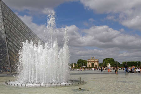 PARIS, France, June 16, 2017 : The Arc de Triomphe du Carrousel and Tuileries Gardens seen from the Louvre courtyard at the foot of Louvre Pyramid