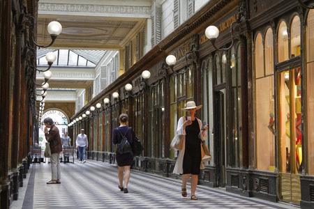 passageways: PARIS, France, June 16, 2017 : The Galerie Vero-Dodat is one of the covered passages of Paris. It was one of the first of Pariss passageways to get gas lighting in 1830, and one of the last to fall into decline.