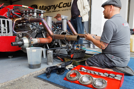 formula one: MAGNY-COURS, FRANCE, June 30, 2017 : Mechanic at work. The First French Historic Grand Prix takes place in Magny-Cours with a lot of ancient sports and Formula one cars. Editorial