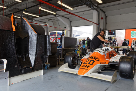 formula one: MAGNY-COURS, FRANCE, June 30, 2017 : Arrows F1 in pits. The First French Historic Grand Prix takes place in Magny-Cours with a lot of ancient sports and Formula one cars. Editorial