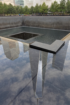 NEW YORK CITY, USA, September 12, 2017 : 911 memorial and the One World Trade Center Tower reflection in Lower Manhattan. One WTC is the tallest building in the Western Hemisphere.