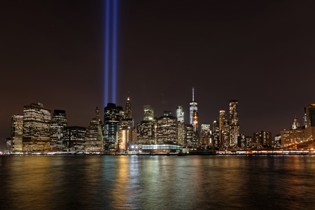 NEW YORK CITY, USA, September 11, 2017 : Two huge blue lights in the sky of Manhattan are a tribute to the twin towers during 16th anniversary memorial ceremony of 911 attacks.