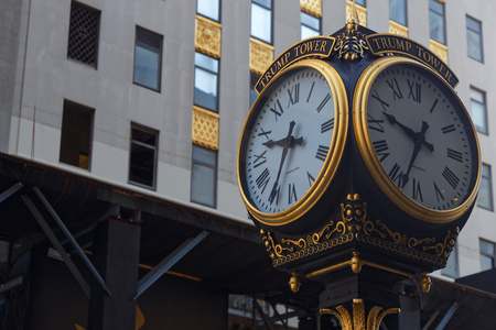 NEW YORK CITY, USA, September 10, 2017 : Clock in front of Trump Tower. Trump Tower serves as the headquarters for The Trump Organization of US President Donald Trump, who was a businessman and real estate developer when the tower was build.