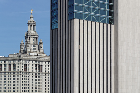 NEW YORK CITY, USA, September 11, 2017 : Manhattan Municipal Building from Brooklyn Bridge. Manhattan Municipal Building is a 40-story building built to accommodate increased governmental space demands after the 1898 consolidation of the citys five borou Editorial
