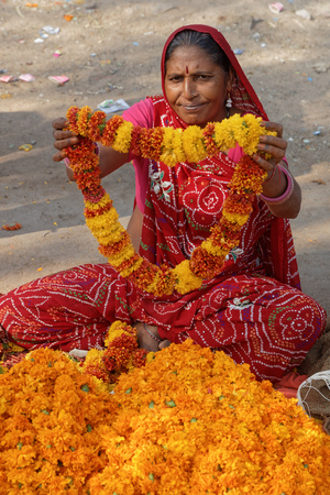 JAIPUR, INDIA, October 26, 2017: In the flower market. Jaipur is a popular tourist destination in India and serves as a gateway to other tourist destinations in Rajasthan.