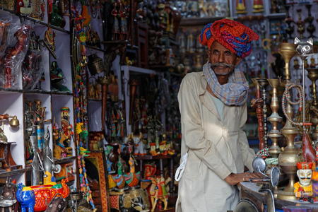 PUSHKAR, INDIA, October 29, 2017 : A man in his store. Pushkar Camel fair is one of the largest cattle fairs in the country with thousands of animals. Editöryel