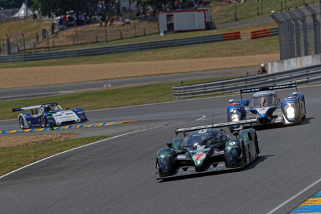 LE MANS, FRANCE, July 7, 2018 : Bentley and Peugeot at the Tertre Rouge during Le Mans Classic on the circuit of the 24 hours. No other event in the world assembles so many old racing cars in the same place than Le Mans Classic.