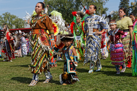 BISMARK, NORTH DAKOTA, September 8, 2018 : Women dancers of the 49th annual United Tribes Pow Wow, one large outdoor event that gathers more than 900 dancers and musicians celebrating native american