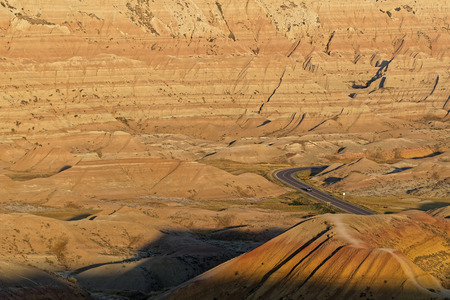 Road in a landscape at sunrise in the Badlands, South Dakota