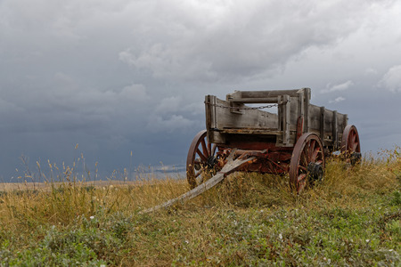 Old Chariot in the meadows near Little Bighorn Battlefield Stock Photo