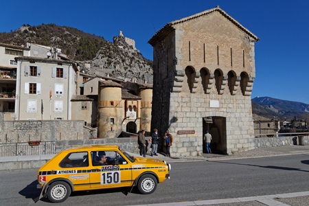 ENTREVAUX, FRANCE, February 5, 2019 : Rally goes trough the medieval village. Rallye Historique is reserved to those cars which have participated in the Rallye Monte-Carlo before 1980. Éditoriale