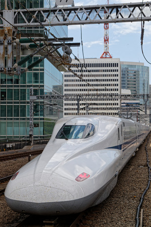 TOKYO, JAPAN, May 16, 2019 : White train enters the station. Shinkansen is a network of high-speed railway lines in Japan, also known in English as the bullet train.