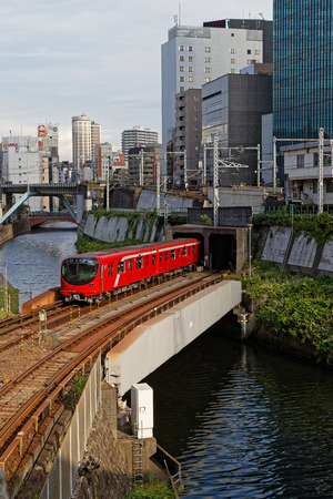 TOKYO, JAPAN, May 15, 2019 : City railway trains crosses in Akihabara district. Railways are the most important means of passenger transportation in Japan.