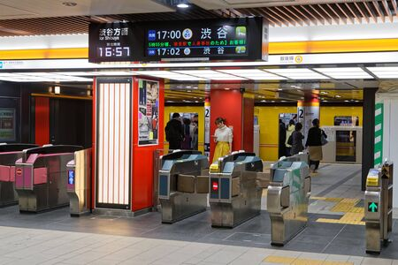 TOKYO, JAPAN, May 9, 2019 :  An underground station in city center.Both the Tokyo Metro and Toei Subway systems are closely integrated with a unified system of line colors, line codes, station numbers. 新聞圖片