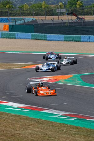 MAGNY-COURS, FRANCE, June 30, 2019 : The F1 pack at the chicane. French Historic Grand Prix takes place on Magny-Cours race track every two years. Sajtókép