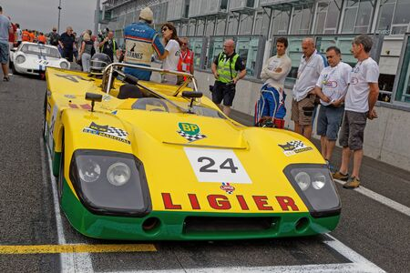 MAGNY-COURS, FRANCE, June 30, 2019 : Sport cars starting grid. French Historic Grand Prix takes place on Magny-Cours race track every two years.