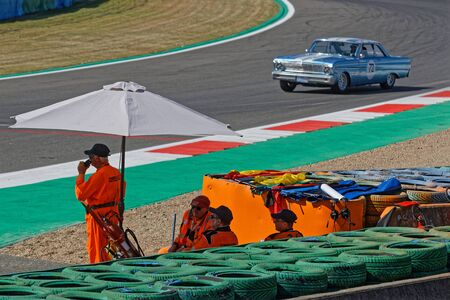 MAGNY-COURS, FRANCE, June 29, 2019 : Marshalls at the chicane. French Historic Grand Prix takes place on Magny-Cours race track every two years.