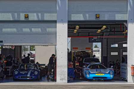 MAGNY-COURS, FRANCE, June 29, 2019 : Sport cars in the pits. French Historic Grand Prix takes place on Magny-Cours race track every two years.