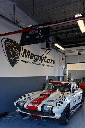 MAGNY-COURS, FRANCE, June 29, 2019 : Sport cars in the pits. French Historic Grand Prix takes place on Magny-Cours race track every two years. Sajtókép