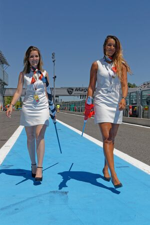 MAGNY-COURS, FRANCE, June 29, 2019 : Famous grid girls have almost disapeared. French Historic Grand Prix takes place on Magny-Cours race track every two years. Editorial