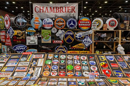 LYON, FRANCE, November 8, 2019 : Old advertising plates at the motorshow. The Salon Epoq Auto stands in Lyon since 1979 with more than 67,000 visitors each year.