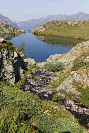 A river flows through the rocks to the Lac Noir